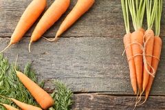 Ripe carrots. Fresh and ripe carrots on wooden table Stock Images