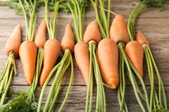 Ripe carrots. Fresh and ripe carrots on wooden table Royalty Free Stock Photo