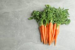 Ripe carrots on grey table stock photos