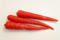 Ripe carrots  on a white background. Red vivid carrots, vegetables, food Royalty Free Stock Photo