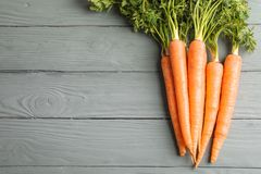 Ripe carrots on wooden background royalty free stock photos