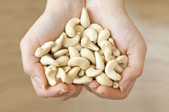 Cashew in hands shaping heart Stock Photo