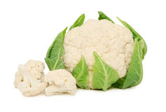 Ripe cauliflower with green leaves (isolated) Royalty Free Stock Image