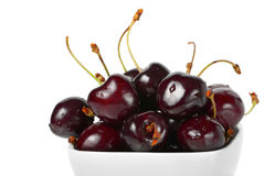 Ripe cherries. Ripe tasty cherries in a white plate Royalty Free Stock Photography