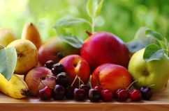Ripe cherries and assorted fruits stock image