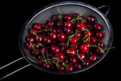 Ripe cherries in the basket strainer Royalty Free Stock Image