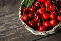 Ripe cherries in basket Stock Photos
