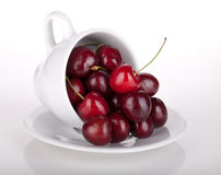 Ripe cherries in a coffee cup Stock Photo