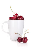 Ripe cherries in a cup. Isolated on white background Stock Photo