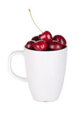 Ripe cherries in a cup. Isolated on white background Stock Images