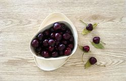 Ripe Cherries in Eco Friendly Bowl with Light Wood Background Stock Image