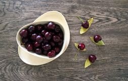 Ripe Cherries in Eco Friendly Bowl with Wood Background Royalty Free Stock Photos
