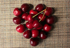 Ripe cherries. In the form of heart Stock Images