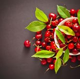 Ripe cherries with green leaves Royalty Free Stock Photos