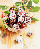 Ripe cherries,ice cubes on wooden table, selective focus Stock Image
