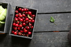 Ripe cherries on a kitchen table Royalty Free Stock Images