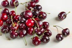 Ripe cherries on a light background concrete. Ripe berry cherry on a light background concrete Stock Photos