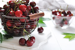 Ripe cherries in a metal basket Stock Photography