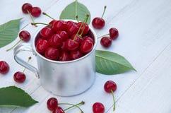Ripe cherries in a metal mug Stock Image