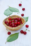 Ripe cherries on an old wooden table Royalty Free Stock Image