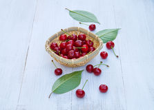 Ripe cherries on an old wooden table Stock Images