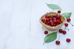 Ripe cherries on an old wooden table Stock Photos