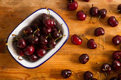 Ripe cherries on rustic wooden background Stock Photo