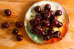 Ripe cherries on rustic wooden background Royalty Free Stock Photography