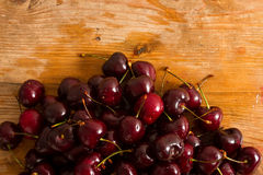Ripe cherries on rustic wooden background Royalty Free Stock Image
