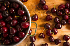 Ripe cherries on rustic wooden background Stock Photos