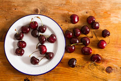 Ripe cherries on rustic wooden background Stock Photography