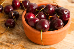 Ripe cherries on rustic wooden background Royalty Free Stock Images