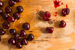 Ripe cherries on rustic wooden background Royalty Free Stock Photo