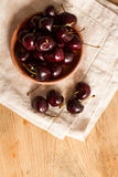 Ripe cherries on rustic wooden background Royalty Free Stock Photos