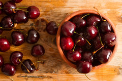 Ripe cherries on rustic wooden background Stock Image