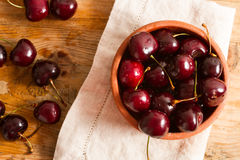 Ripe cherries on rustic wooden background Stock Images