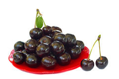 Ripe cherries in a small red platter Royalty Free Stock Photography