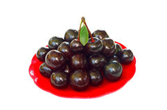 Ripe cherries in a small red platter Royalty Free Stock Photos