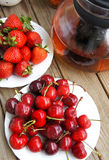 Ripe cherries and strawberries Stock Photos