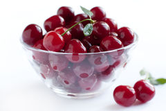 Ripe cherries in a transparent plate stock photo