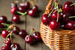 Ripe cherries in wicker basket basket Stock Photos