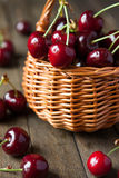 Ripe cherries in wicker basket Stock Photo
