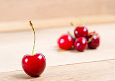 Ripe cherries on wood background Stock Photography