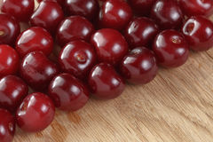 Ripe cherries on wood table Royalty Free Stock Images