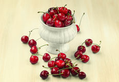 Ripe cherries on a wooden background Stock Images