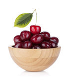 Ripe cherries in a wooden bowl Stock Image