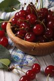 Ripe cherries in a wooden bowl closeup. vertical Stock Photo