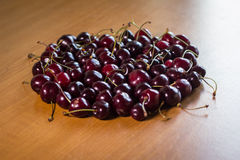 Ripe cherries on wooden table Royalty Free Stock Photography