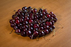 Ripe cherries on wooden table Royalty Free Stock Photos