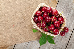 Ripe cherries on wooden table stock photo